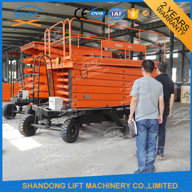 China Hydraulic Electric Mobile Platform Lift Mobile Scissor Lift Table Pull type supplier