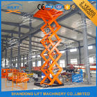 China 7M 2T Warehouse Cargo Loading Hydraulic Lift Platform Orange company