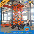 China 300kg 500kg Towed Mobile Mobile Platform Lift Electric Hydraulic 12m Lifting Height factory