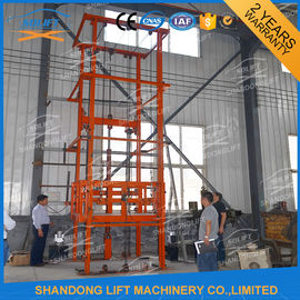 China 1T 12m CE Approved Vertical Guide Rail Elevators Hydraulic Warehouse Cargo Lift distributor